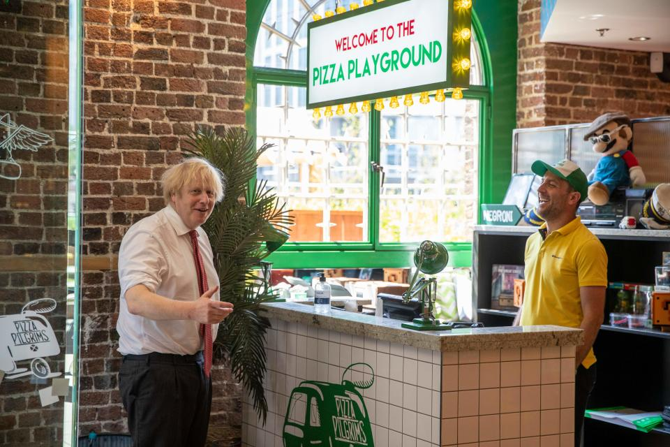 Britain's prime minister Boris Johnson visits Pizza Pilgrims in West India Quay, London Docklands. Photo: Heathcliff O'Malley/AFP via Getty