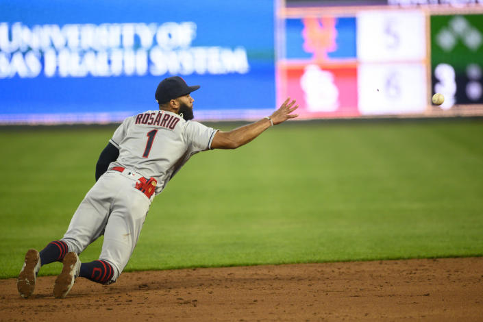 Cleveland Indians shortstop Amed Rosario tossed the ball to second for a force-out during the third inning of a baseball game Monday, May 3, 2021, in Kansas City, Mo. (AP Photo/Reed Hoffmann)