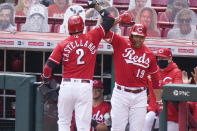 Cincinnati Reds Nick Castellanos (2) celebrates with Joey Votto (19) after hitting a home run during the sixth inning of a baseball game against the Arizona Diamondbacks at Great American Ball Park in Cincinnati, Thursday, April 22, 2021. (AP Photo/Bryan Woolston)