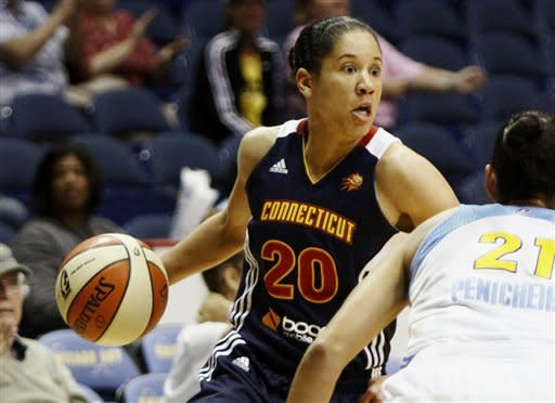 Connecticut Sun's Kara Lawson (20) attempts to get past Chicago Sky's Ticha Penicheiro during the first half of a WNBA basketball game on Tuesday, Aug. 28, 2012, in Rosemont, Ill. (AP Photo/Sitthixay Ditthavong)