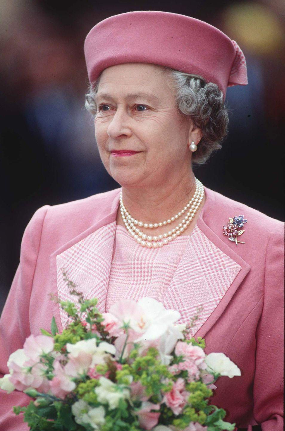 <p>A pink pillbox hat is an underrated classic, as the Queen showed in 1992.</p>