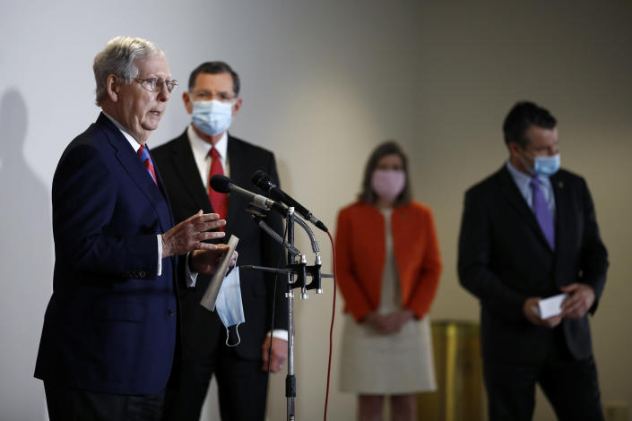 Senate Majority Leader Mitch McConnell of Ky., left, speaks at a news conference on Capitol Hill in Washington, Tuesday, May 12, 2020. Standing behind McConnell are Sen. John Barrasso, R-Wyo., from back left, Sen. Joni Ernst, R-Iowa, and Sen. Todd Young, R-Ind. (AP Photo/Patrick Semansky)