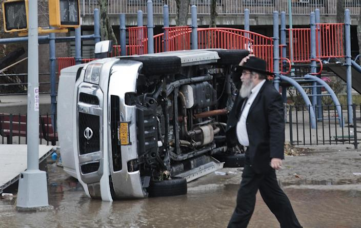 A van is flipped on its side in the aftermath of flooding caused by superstorm Sandy on Tuesday, Oct. 30, 2012, in the Coney Island section of the Brooklyn borough of New York. Sandy, the storm that made landfall Monday, caused multiple fatalities, halted mass transit and cut power to more than 6 million homes and businesses. (AP Photo/Bebeto Matthews)