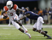 Houston's Deontay Greenberry (3) tries to avoid Texas San Antonio's Triston Wade (7) after making a catch for a first down during the first half of an NCAA college football game on Saturday, Sept. 28, 2013, in San Antonio. (AP Photo/Eric Gay)
