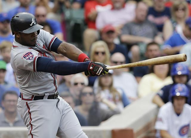 Atlanta Braves' Justin Upton hits a three-run double against the Chicago Cubs during the fourth inning of a baseball game in Chicago, Saturday, July 12, 2014. (AP Photo/Nam Y. Huh)