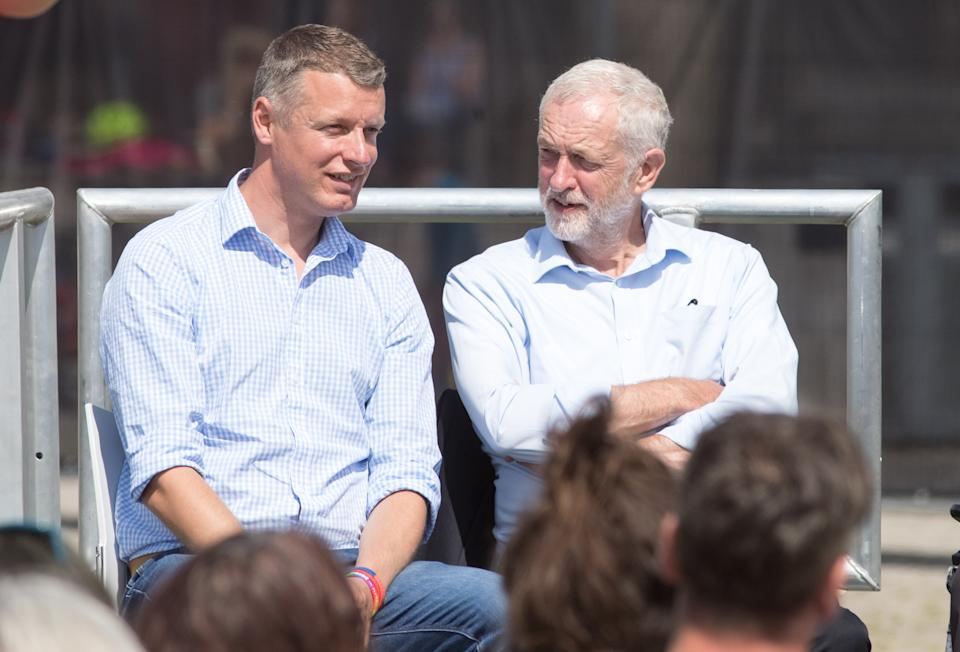 REDRUTH, ENGLAND - AUGUST 10:  Labour leader Jeremy Corbyn speaks with Labour MP Luke Pollard at a campaign rally at Heartlands in Camborne on August 10, 2017 near Redruth, England. The Labour leader chose the old mining area in the heart of Cornwall to start a  series of campaigning events across the country to prepare for the next election..  (Photo by Matt Cardy/Getty Images)