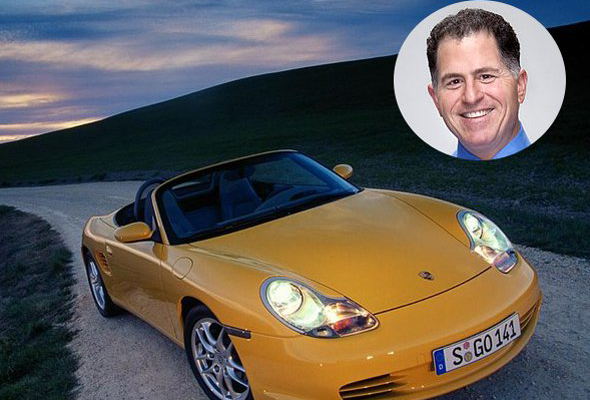 Laptop mogul Michael Dell drives an edgy, 2004 Porsche Boxter. Although a new model could cost you well above $80,000, you could buy this model used for under $20,000. information via automotoportal.com and cars.com.