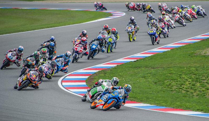 Estrella Galicia 0,0's Spanish rider Alex Marquez leads pack of riders during the Czech Republic's Grand Prix in Moto 3 on August 17, 2014, in Brno, Czech Republic (AFP Photo/Joe Klamar )