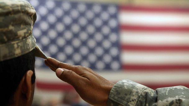 PHOTO: A soldier salutes the flag during a welcome home ceremony for troops arriving from Afghanistan in this June 15, 2011 file photo to Fort Carson, Colo. (John Moore/Getty Images, FILE)