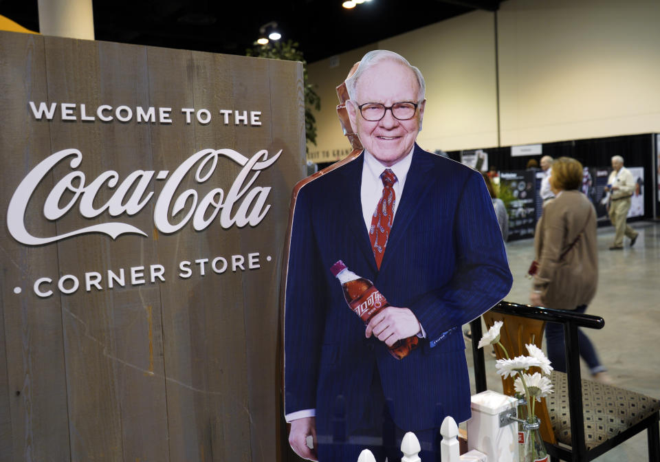 A cutout of Berkshire Hathaway Chairman and CEO Warren Buffett welcomes Berkshire shareholders to the Coca Cola exhibit at the CenturyLink Center in Omaha, Neb., Friday, May 4, 2018, where Berkshire brands display their products and services. On Saturday, shareholders are expected to fill the CenturyLink arena as they attend the annual Berkshire Hathaway shareholders meeting where Buffett and his Vice Chairman Charlie Munger preside over a Q&A session. (AP Photo/Nati Harnik)