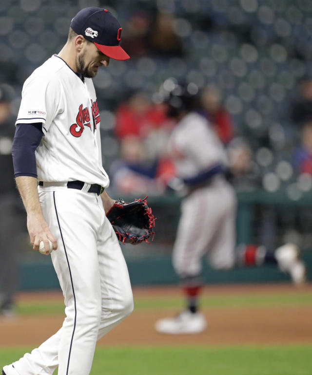 Cleveland Indians relief pitcher Dan Otero, left, waits for Atlanta Braves' Dansby Swanson, right, to run the bases after Swanson hit a two-run home run in the seventh inning during the second game of a baseball doubleheader, Saturday, April 20, 2019, in Cleveland. Johan Camargo scored on the play. (AP Photo/Tony Dejak)