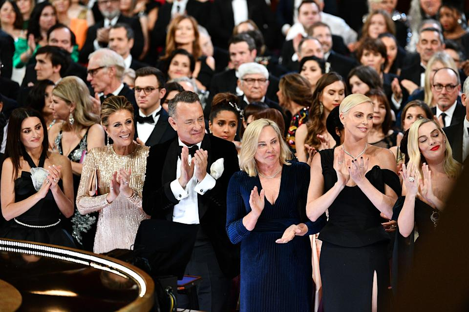 HOLLYWOOD, CALIFORNIA - FEBRUARY 09: In this handout photo provided by A.M.P.A.S. Penélope Cruz, Rita Wilson, Tom Hanks, Charlize Theron, and Margot Robbie stand in the front row during the 92nd Annual Academy Awards at the Dolby Theatre on February 09, 2020 in Hollywood, California. (Photo by Richard Harbaugh - Handout/A.M.P.A.S. via Getty Images)