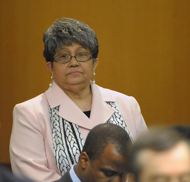 Former Atlanta Public Schools Superintendent Beverly Hall stands as her attorney presents a motion at the Fulton County Superior Court hearing for several dozen Atlanta Public Schools educators facing charges alleging a conspiracy of cheating on the CRCT standardized tests in Atlanta, Friday, May 3, 2013. (AP Photo/David Tulis)