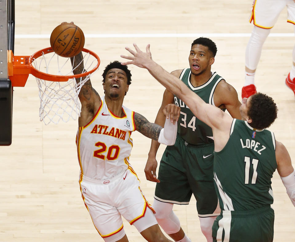 Atlanta Hawks forward John Collins dunks against the Bucks during an impressive win on Sunday. (Photo by Michael Zarrilli/Getty Images)
