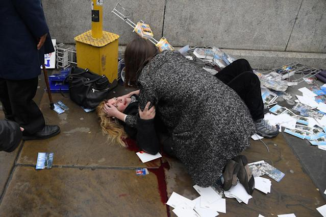 <p>MAR. 22, 2017 – A woman lies injured after a shooting incident on Westminster Bridge in London. (Photo: Toby Melville/Reuters) </p>
