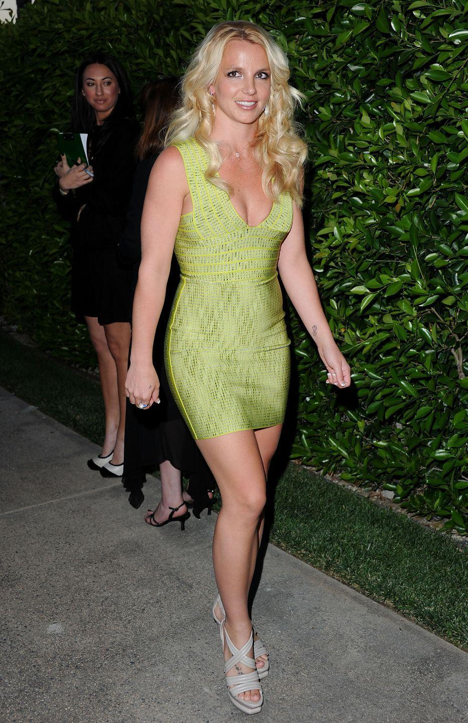 <p>Brit is glowing! Maybe it's the bright bodycon dress or her radiant smile. Whatever it is, she's rockin' the look. </p>