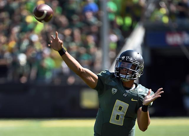 Oregon quarterback Marcus Mariota (8) passes the ball during the second quarter against Wyoming during an NCAA college football game at Autzen Stadium, Saturday, Sept. 13, 2014, in Eugene, Ore. (AP Photo/Steve Dykes)