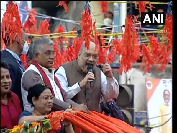 Union Home Minister Amit Shah (speaking) accompanied by WB BJP chief Dilip Ghosh (to his right) at a roadshow in Birbhum district on Sunday [Photo/ANI]