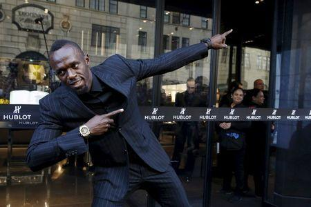"""Olympic sprinter Usain Bolt poses during a ribbon cutting ceremony to celebrate the opening of the flagship """"Hublot"""" store on Fifth Avenue in the Manhattan borough of New York, U.S., April 19, 2016. REUTERS/Andrew Kelly"""