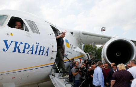 Ukrainian film directorOlegSentsov, who was jailed on terrorism charges in Russia, gets off a plane upon arrival in Kiev after Russia-Ukraine prisoner swap, at Borispil International Airport