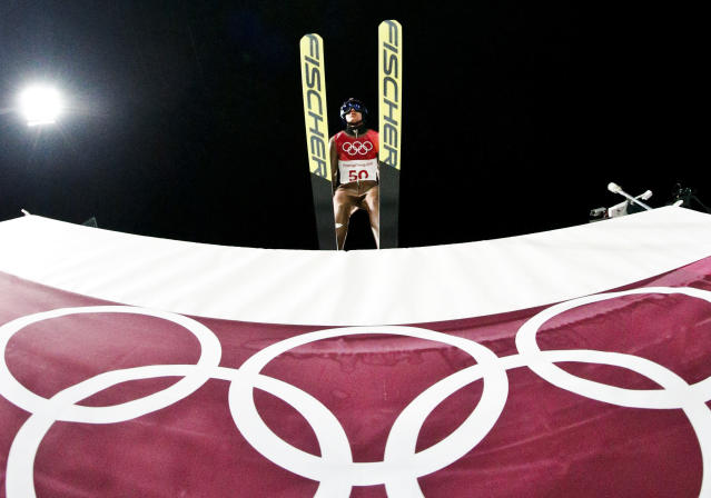 <p>Kamil Stoch, of Poland, goes off the jump during the men's normal hill individual ski jumping competition at the 2018 Winter Olympics in Pyeongchang, South Korea, Saturday, Feb. 10, 2018. (AP Photo/Dmitri Lovetsky) </p>