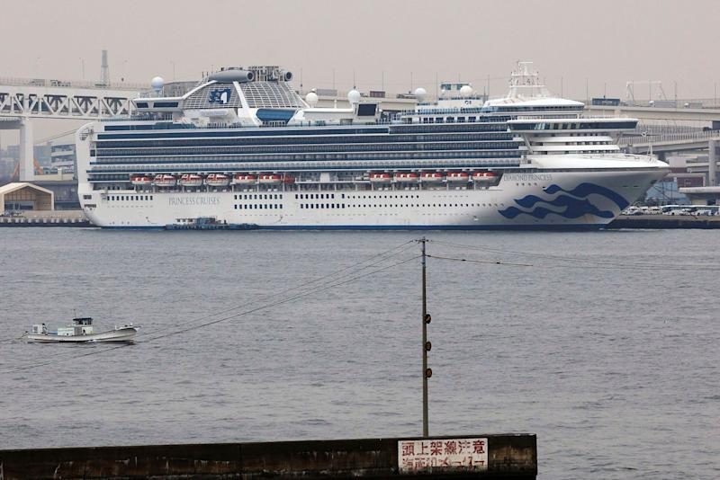 The Diamond Princess cruise ship is anchored at a port in Yokohama, Tuesday, Feb. 25, 2020. Japanese health officials and experts on a government panel acknowledged Monday that the quarantine of the virus-hit cruise ship was not perfect, but defended Japan's decision to release about 1,000 passengers after 14 days. (Kyodo News via AP) (Photo: ASSOCIATED PRESS)