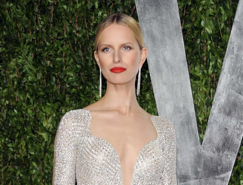 "FILE - This Feb. 26, 2012 file photo shows model Karolina Kurkova at the Vanity Fair Oscar party in West Hollywood, Calif.  Oxygen Media announced Wednesday that 28-year-old Kurkova will be the third coach on the new reality competition for up-and-coming models, working alongside Naomi Campbell and Coco Rocha. Photographer Nigel Barker, the former judge from ""America's Next Top Model"" will serve as host. (AP Photo/Evan Agostini, file)"