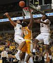 Valparaiso's Jubril Adekoya, center, has his shot blocked by Missouri's Keanau Post, left, as D'Angelo Allen, right, defends during the second half of an NCAA college basketball game Sunday, Nov. 16, 2014, in Columbia, Mo. Missouri won the game 56-41. (AP Photo/L.G. Patterson)