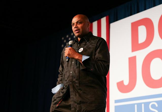 Former NBA basketball player Charles Barkley speaks to the crowd for his support of Democratic Alabama U.S. Senate candidate Doug Jones, during a rally at Old Car Heaven in Birmingham, Alabama, U.S. December 11, 2017. REUTERS/Marvin Gentry