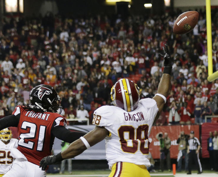 Washington Redskins wide receiver Pierre Garcon (88) tries to catch a ball during a two-point conversion against Atlanta Falcons cornerback Desmond Trufant (21) during the second half of an NFL football game, Sunday, Dec. 15, 2013, in Atlanta. The Atlanta Falcons won 27-26. (AP Photo/John Bazemore)