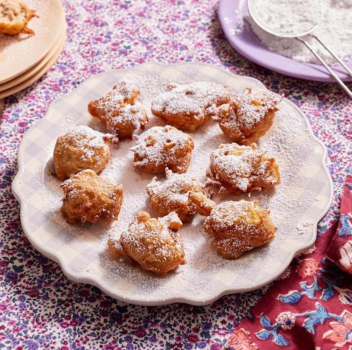 """<p>Don't skimp on these little apple nuggets. You can make them in advance and heat them up in a 350-degree oven for 8 to 10 minutes.</p><p><a href=""""https://www.thepioneerwoman.com/food-cooking/recipes/a8907/apple-fritters/"""" rel=""""nofollow noopener"""" target=""""_blank"""" data-ylk=""""slk:Get Ree's recipe."""" class=""""link rapid-noclick-resp""""><strong>Get Ree's recipe.</strong></a></p>"""