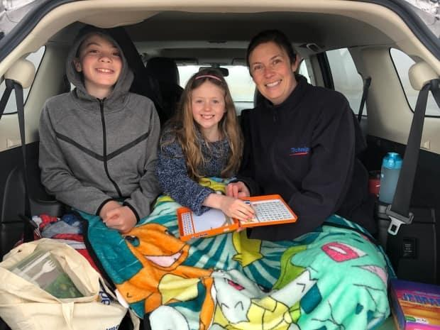 The Sharpe family had planned to eat their picnic on a bench, but found the back of their car a little cozier.