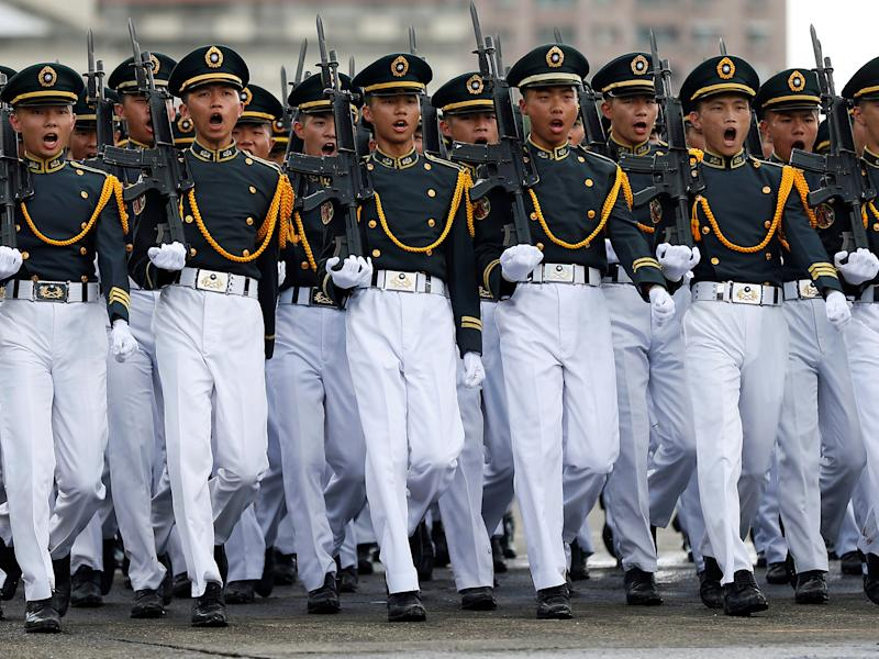 Taiwanese cadets march during a ceremony to mark the 92nd anniversary of the Whampoa Military Academy, in Kaohsiung, southern Taiwan: REUTERS/Tyrone Siu