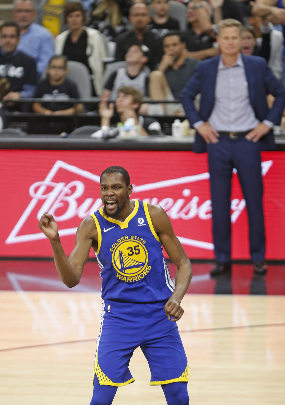 SAN ANTONIO,TX - APRIL 19: Kevin Durant #35 of the Golden State Warriors reacts after a Klay Thompson #11 of the Golden State Warriors basket against the San Antonio Spurs at AT&T Center on April 19 , 2018 in San Antonio, Texas. (Photo by Ronald Cortes/Getty Images)