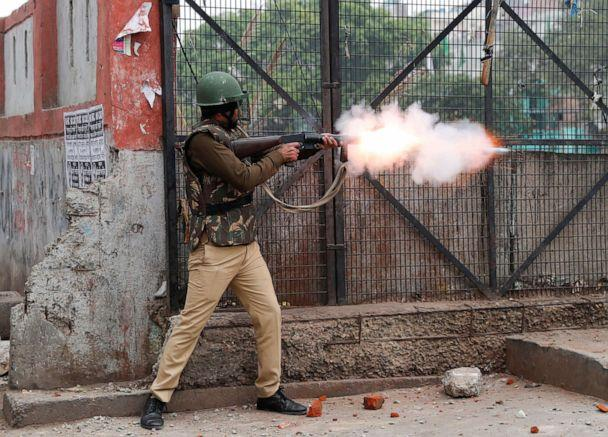 PHOTO: A riot police officer fires tear gas during a protest against a new citizenship law in Seelampur, an area of Delhi, India Dec. 17, 2019. (Danish Siddiqui/Reuters)