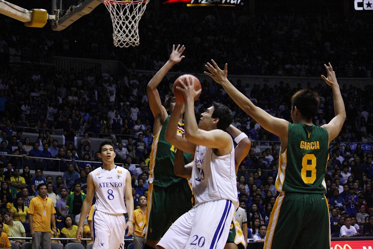 Greg Salughter of Ateneo Blue Eagles goes for the basket during the UAAP Season 74 second game of the best-of-three championship series against FEU Tamaraws held at Smart Araneta Coliseum in Quezon City. (Marlo Cueto/NPPA Images)