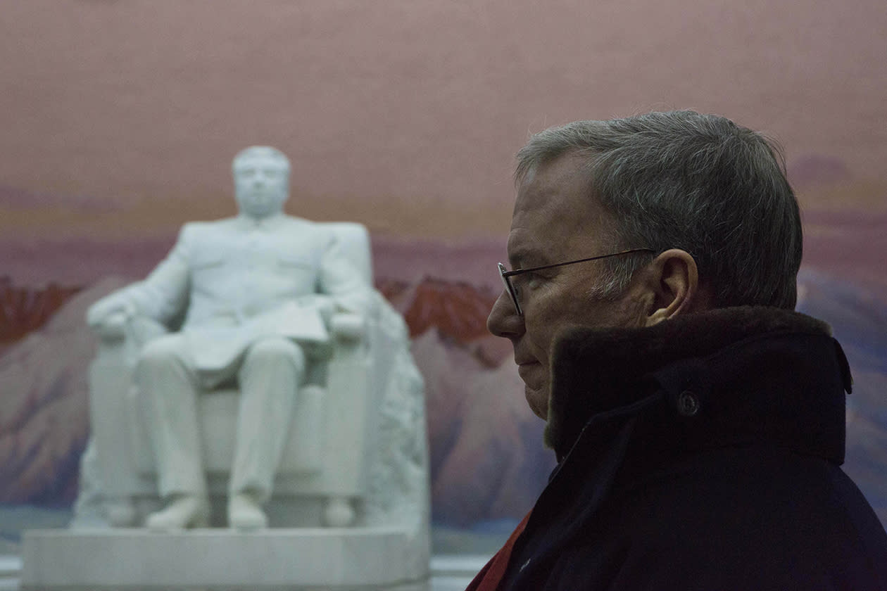 Executive Chairman of Google, Eric Schmidt stands near a statue of the late North Korean leader Kim Il Sung during a tour of the Grand Peoples Study House in Pyongyang, North Korea.
