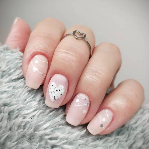"<p>Garland doesn't stop the day after Christmas. Add a touch of it to your nails but, then add hearts.</p><p><a href=""https://www.instagram.com/p/CKQfq9uMOJR/?utm_source=ig_embed&utm_campaign=loading"" rel=""nofollow noopener"" target=""_blank"" data-ylk=""slk:See the original post on Instagram"" class=""link rapid-noclick-resp"">See the original post on Instagram</a></p>"
