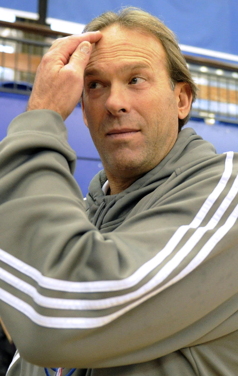 Timberwolves coach Kurt Rambis speaks to a journalist during a training session, London, Sunday, Oct. 3, 2010. The Lakers will face the Timberwolves at the O2 Arena, London, Monday.(AP Photo/Tom Hevezi)