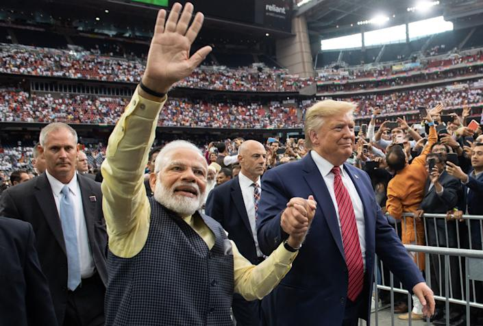 """Modi and Trump, two nationalist-minded leaders, attend the """"Howdy Modi"""" rally at NRG Stadium in Houston on Sept. 22, 2019. (Photo: SAUL LOEB/AFP via Getty Images)"""