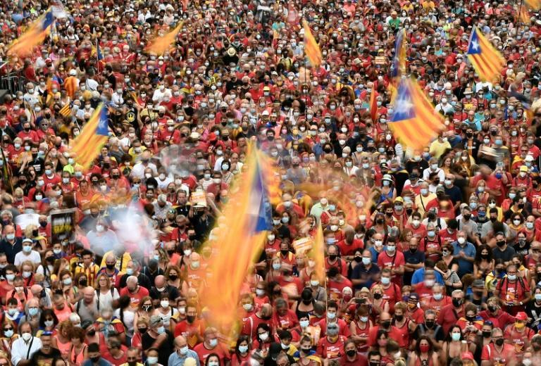 At the weekend, tens of thousands of people turned out for Catalonia's national day, many waving pro-independence Estelada flags (AFP/Josep LAGO)