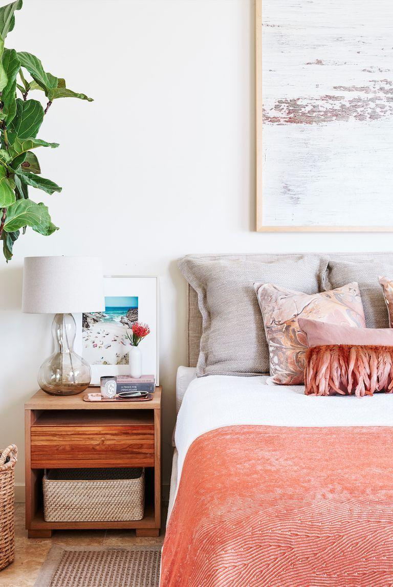 <p>For an ocean-inspired look, dress up your bedroom with plush pillows and throws, large-scale art, and statement greenery. <br></p>