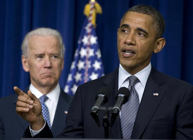 """FILE - In this Jan. 16, 2013 file photo, President Barack Obama, accompanied by Vice President Joe Biden, talks about proposals to reduce gun violence, in the South Court Auditorium at the White House in Washington. This is what """"Forward"""" looks like. Fast forward, even. President Barack Obama's campaign slogan is springing to life in a surge of executive directives and agency rulemaking touching many of the affairs of government. They are shaping the cost and quality of health plans, the contents of the school cafeteria, the front lines of future combat, the price of coal. They are the leading edge of Obama's ambition to take on climate change in ways that may be unachievable in legislation.  (AP Photo/Carolyn Kaster, File)"""