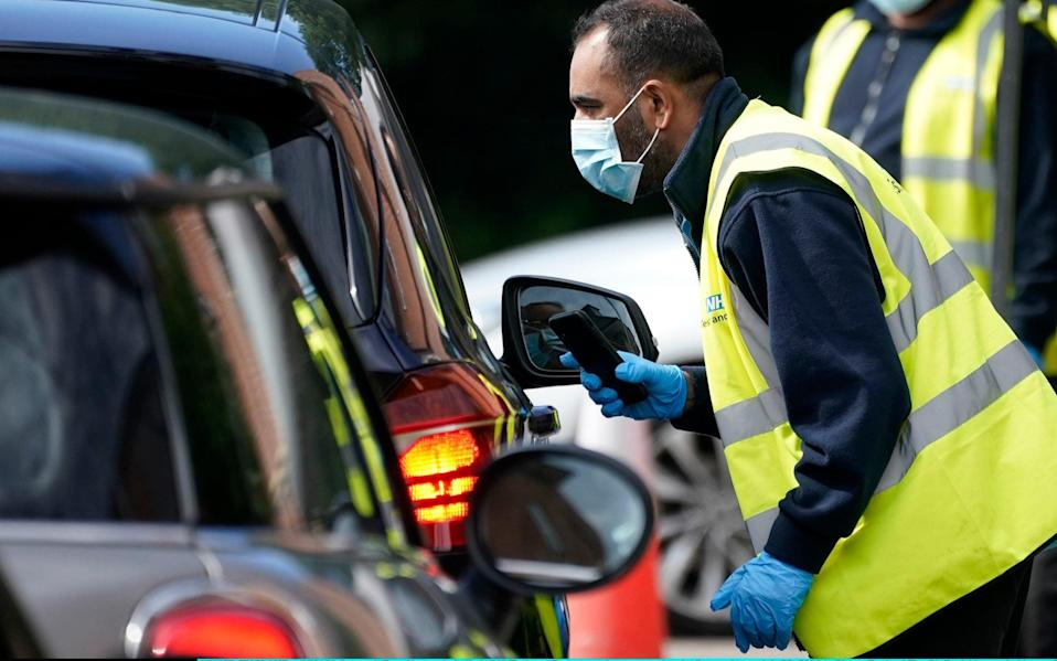 Serco staff working on behalf of NHS Test and Trace operate a coronavirus testing centre in Stone, England - Christopher Furlong/Getty Images Europe