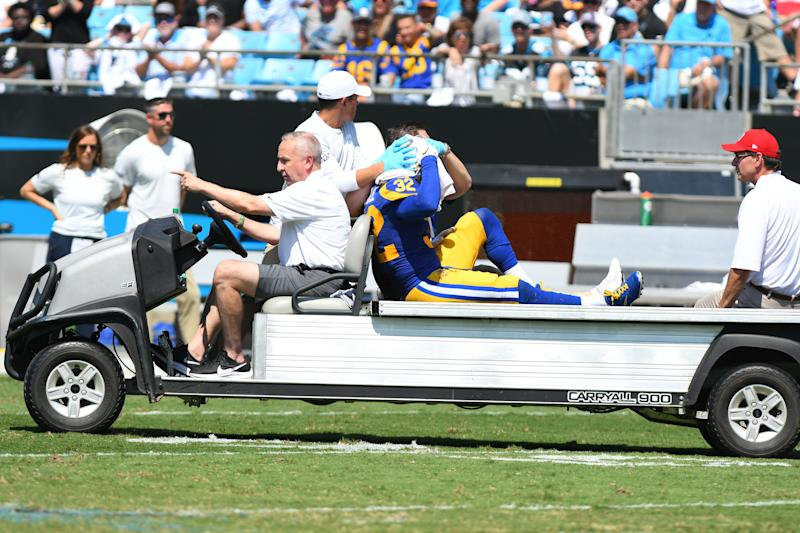 CHARLOTTE, NC - SEPTEMBER 08: Los Angeles Rams free safety Eric Weddle (32) gets carted off the field after getting injured on a tacle attempt on Carolina Panthers running back Christian McCaffrey (22) during the game between the Los Angeles Rams and the Carolina Panthers on September 08, 2019 at Bank of America Stadium in Charlotte,NC. (Photo by Dannie Walls/Icon Sportswire via Getty Images)
