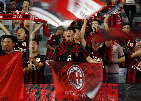 FILE PHOTO: Chinese fans of AC Milan sing before their team's International Champions Cup friendly match against Inter Milan in Shenzhen, China, July 25, 2015. REUTERS/Bobby Yip/File Photo