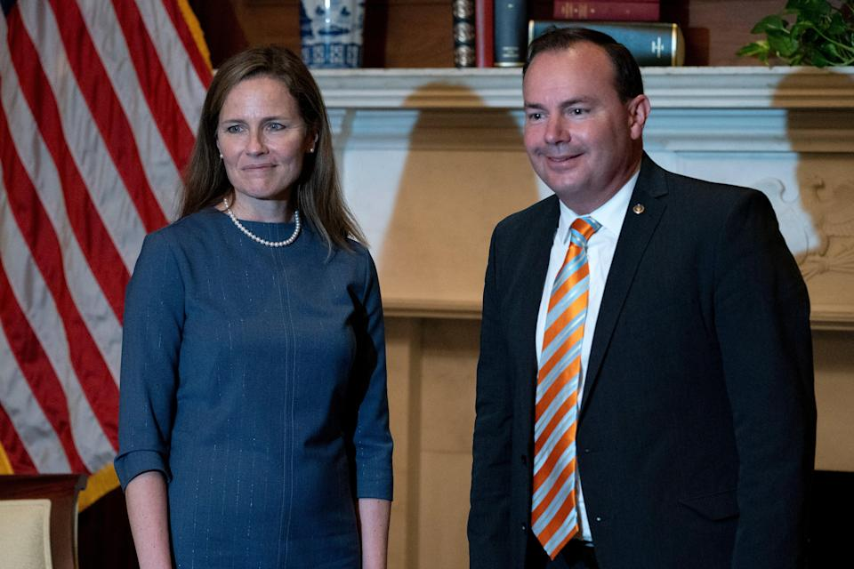 Senator Mike Lee, right, with Supreme Court Justice Amy Coney Barrett at the White House in September. (Getty Images)
