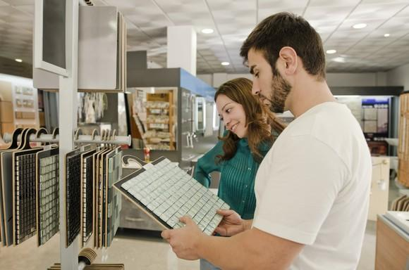 Young man and woman shopping in a tile store.
