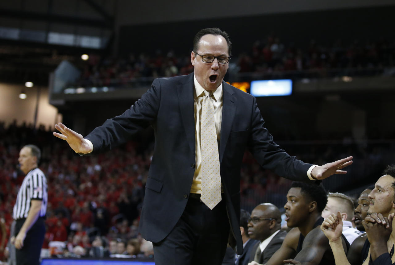 Wichita State head coach Gregg Marshall shouts during the first half of an NCAA college basketball game against Cincinnati, Sunday, Feb. 18, 2018, in Highland Heights, Ky. (AP Photo/Gary Landers)