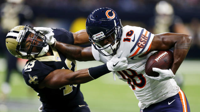 <p>Chicago Bears wide receiver Tre McBride (18) stiff arms New Orleans Saints free safety Marcus Williams (43) in the first half of an NFL football game in New Orleans, Sunday, Oct. 29, 2017. (AP Photo/Butch Dill) </p>